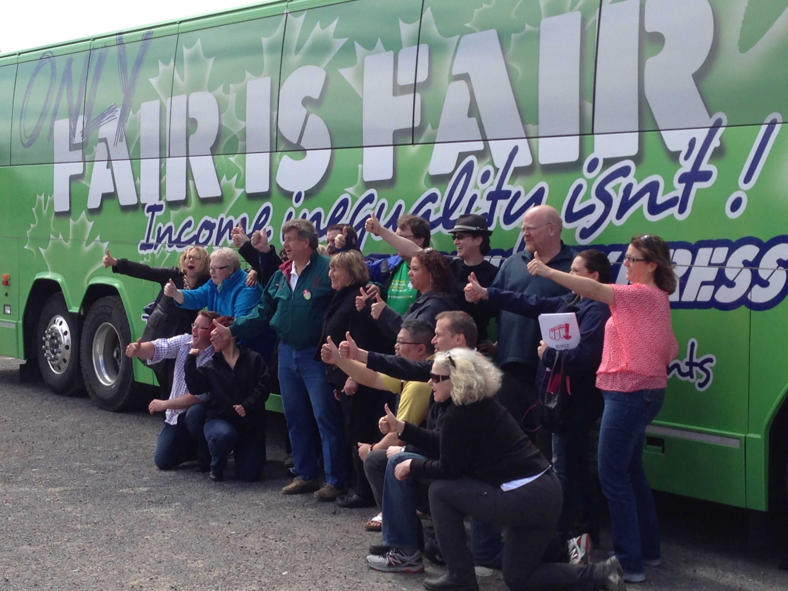 OPSEU members posing in front of a bus that says: Only fair is fair!