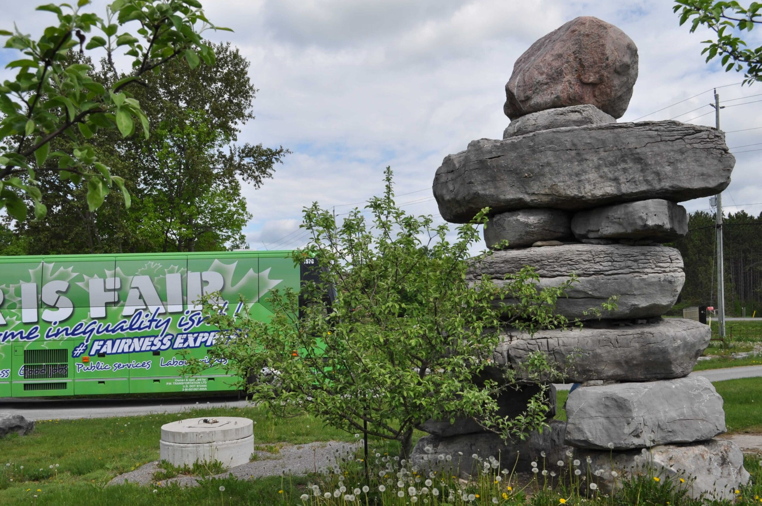 Rocks in formation. Bus that says: Fair is Fair in the background