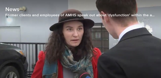 Woman being interviewed by a reporter