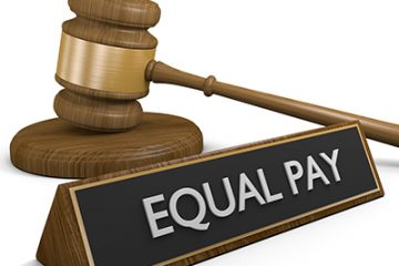 Equal pay sign next to gavel