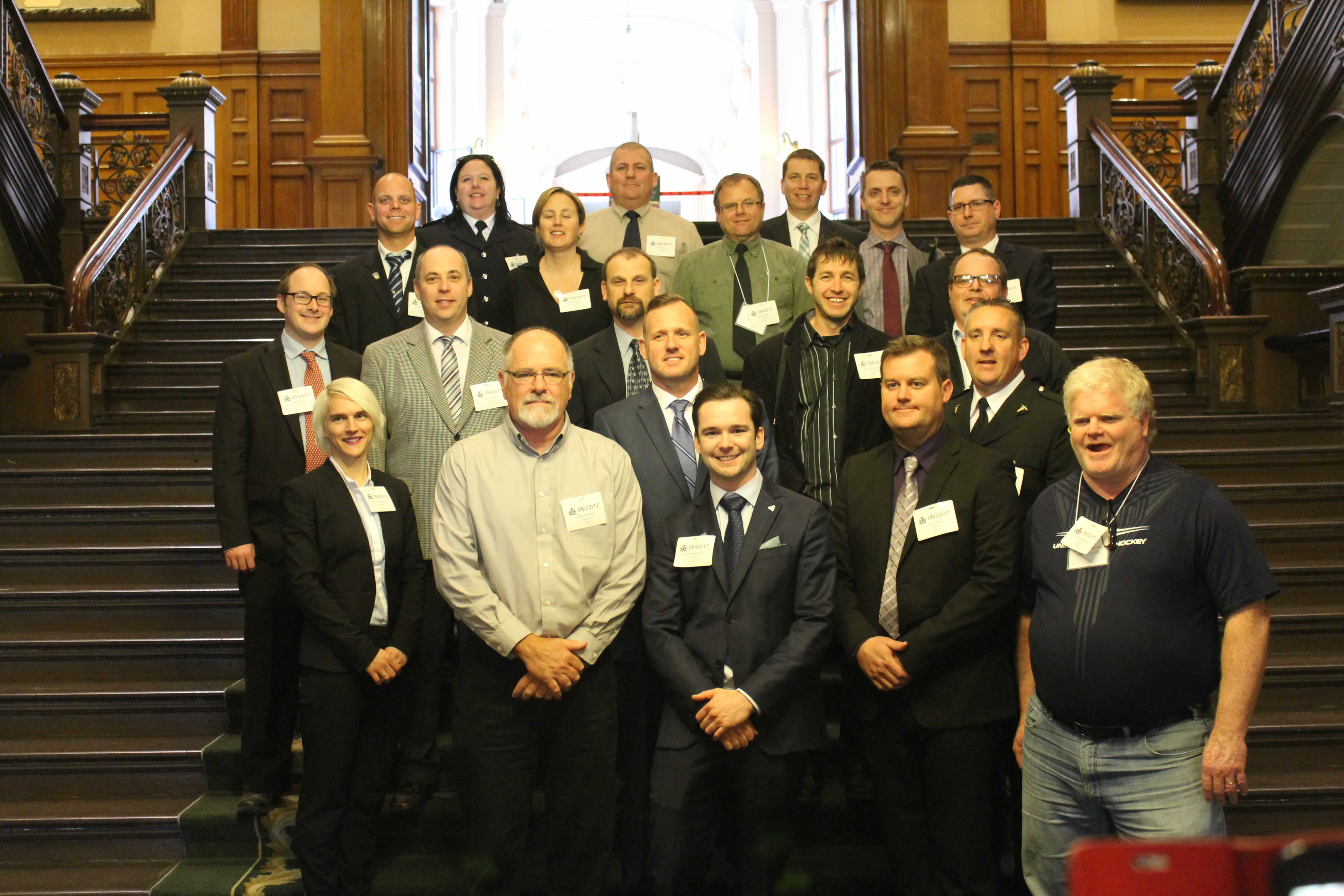OPSEU Paramedic members pose on the stairs at Queen's Park during a lobby day.