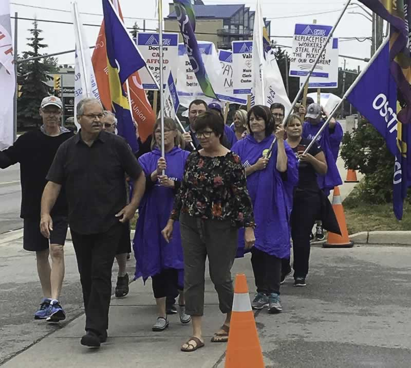 OPSEU President Warren (Smokey) Thomas leads a march in support of striking Local 276 members in Owen Sound.