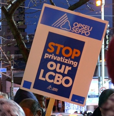 """Picket sign reading """"Stop privatizing our LCBO"""" at a rally."""