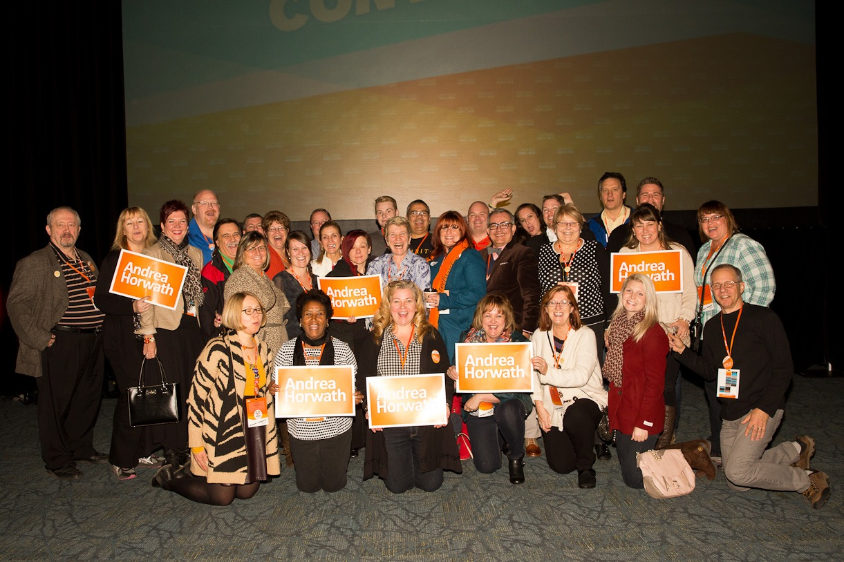 Large group of OPSEU members, many holding Andrea Horwath signs, at the ONDP Convention