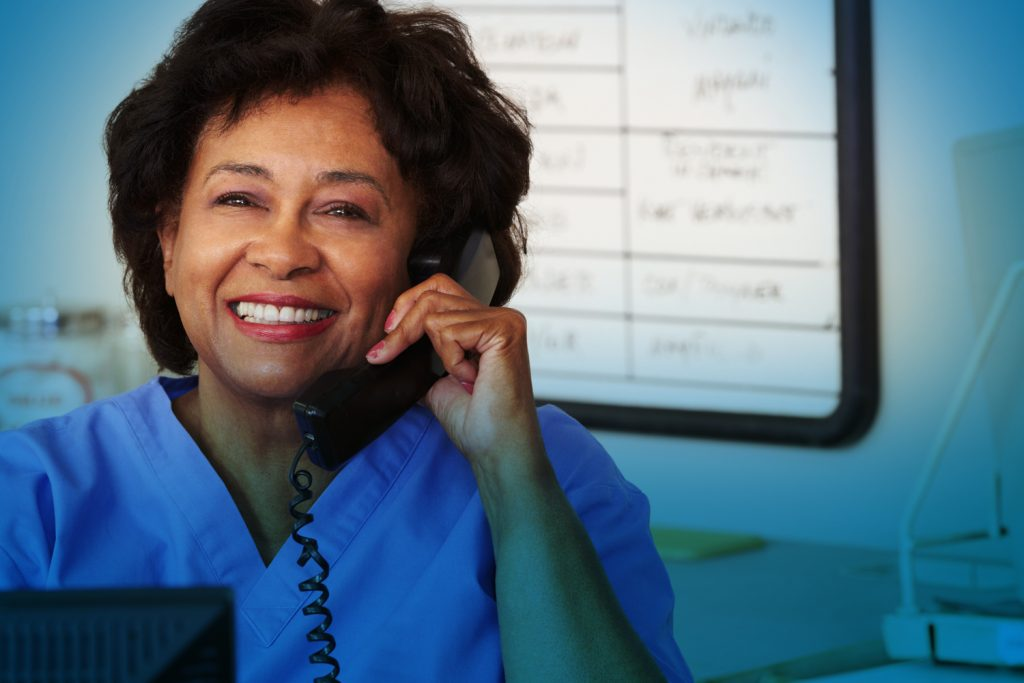 Healthcare worker holding phone
