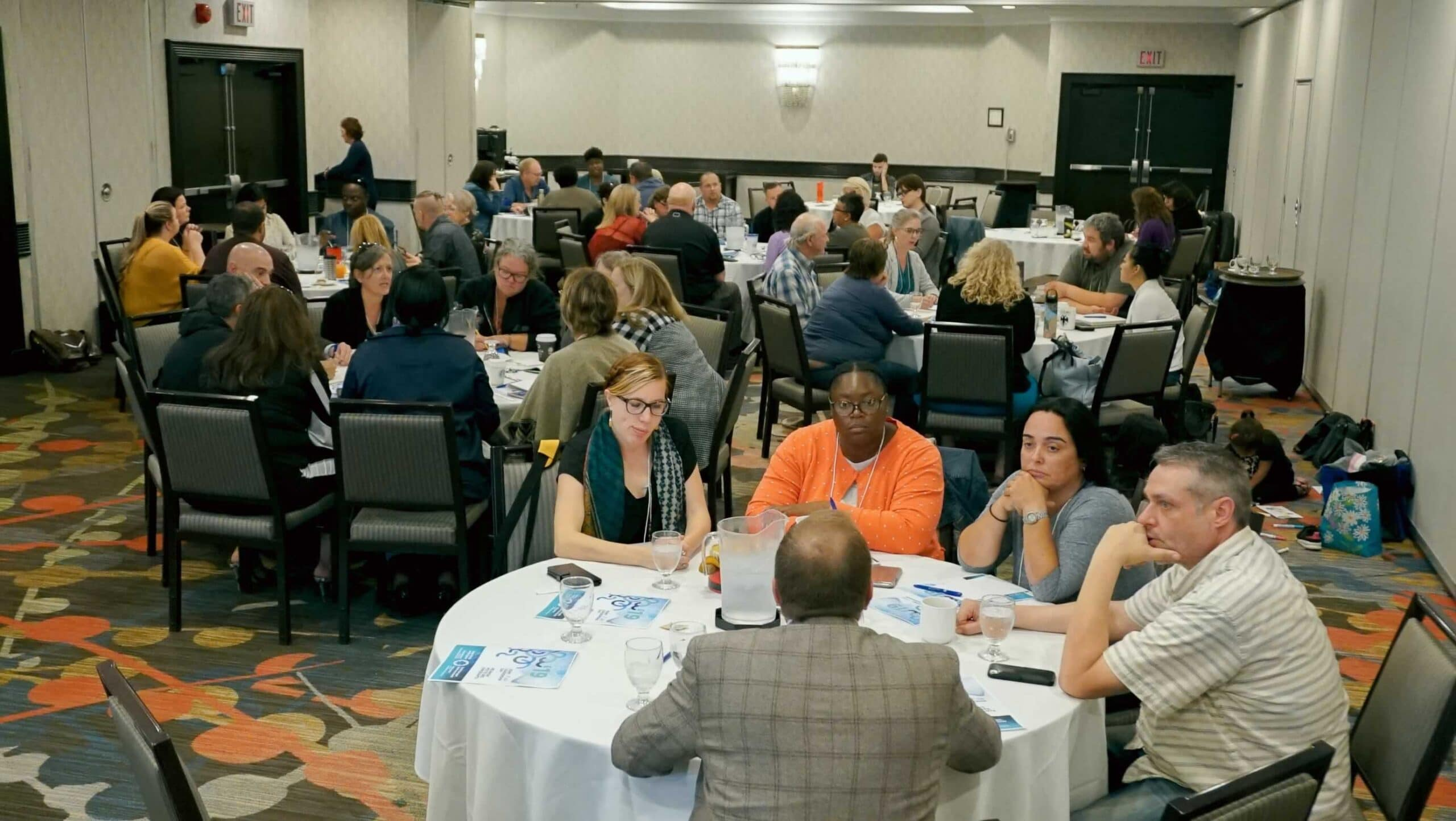 OPSEU members sitting around tables talking