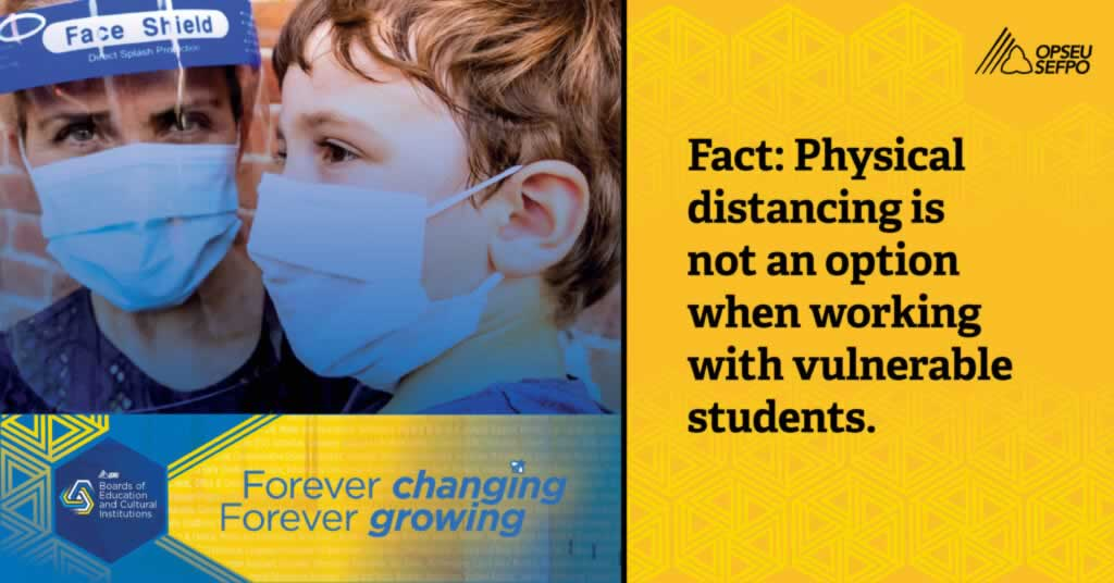 Woman & child wearing PPE. Fact: Physical distancing is not an option when working with vulnerable students